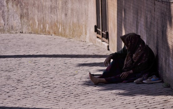 begging-old-person-2128-554x350