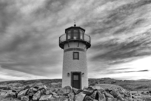 dark-clouds-hills-lighthouse-367-525x350
